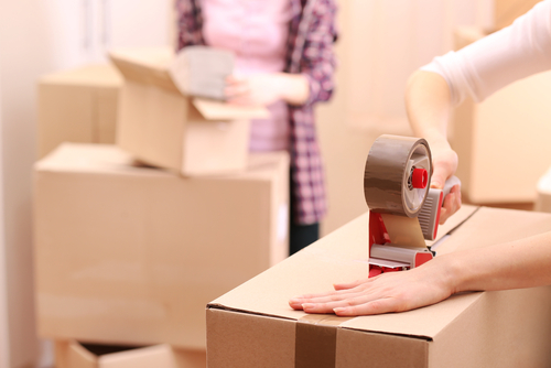 Packing and Taping New Boxes for Storage of your Belongings