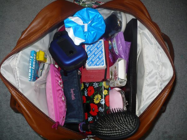 A picture containing indoor, items, clothes, cluttered  Description automatically generated