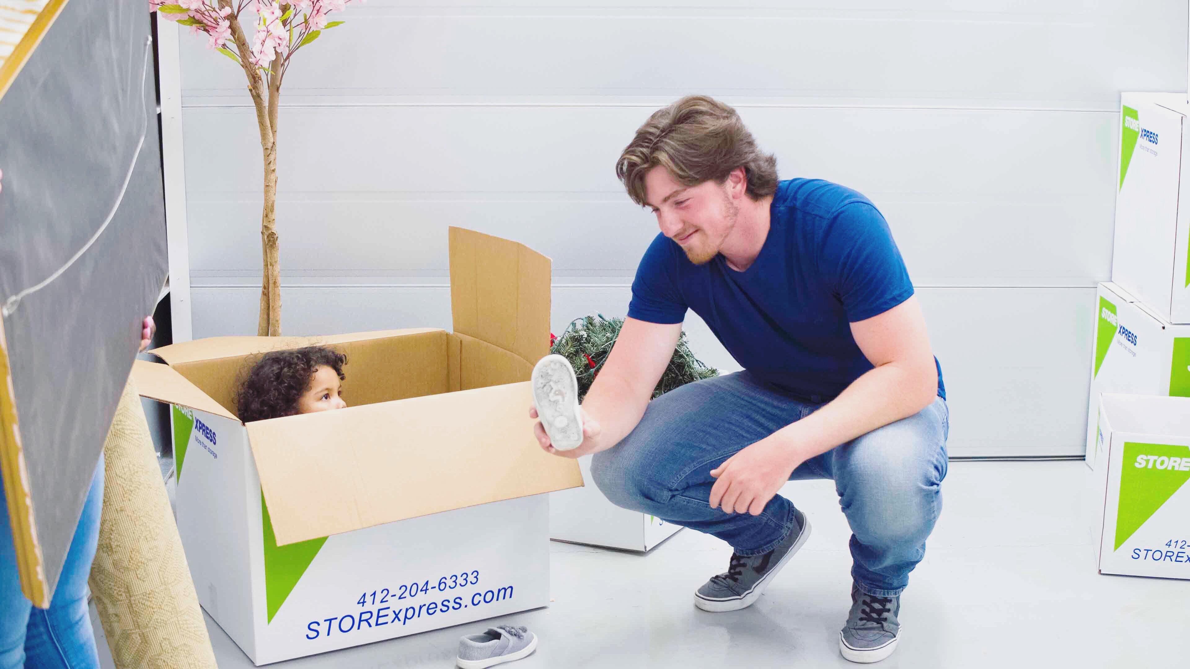 People moving into a STORExpress Storage Unit