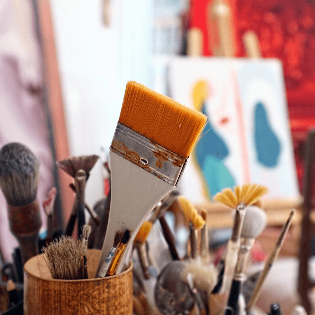 art studio with paint brushes in containers