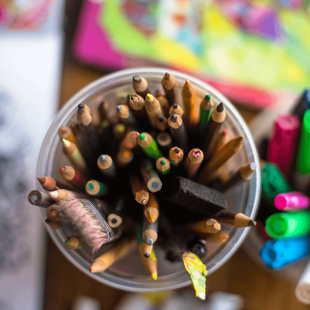 colored pencils in a storage container