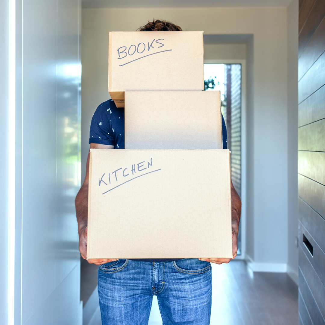 man holding his moving boxes